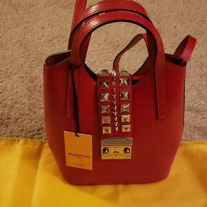 Valentino red studded backpack clutch bag